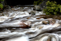 Merced River Swirls with white Foam. Yosemite National Park. California.