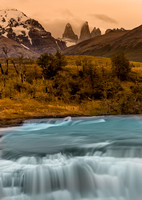 River and waterfall with Las Torres in background. Torres del Paine National Park. Chile. South America. Unesco biosphere.