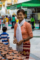 Preparing the candle lights. Shwedagon Pagoda. Yangon. Myanmar.