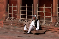 Resting man at Jama Mashid, mosque.Delhi. India.