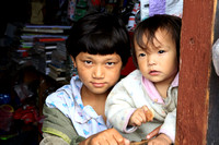 Children in shop window, Bhutan