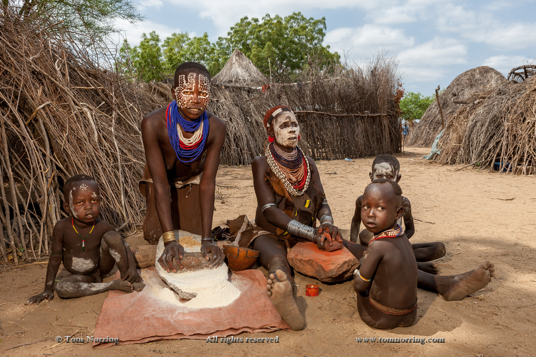 Kara tribal food preparation. Kolcho Village. Omo Valley. Ethiopia,Africa.