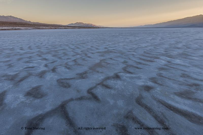 Cracked Salt Flats at sunset. Death Valley. California.