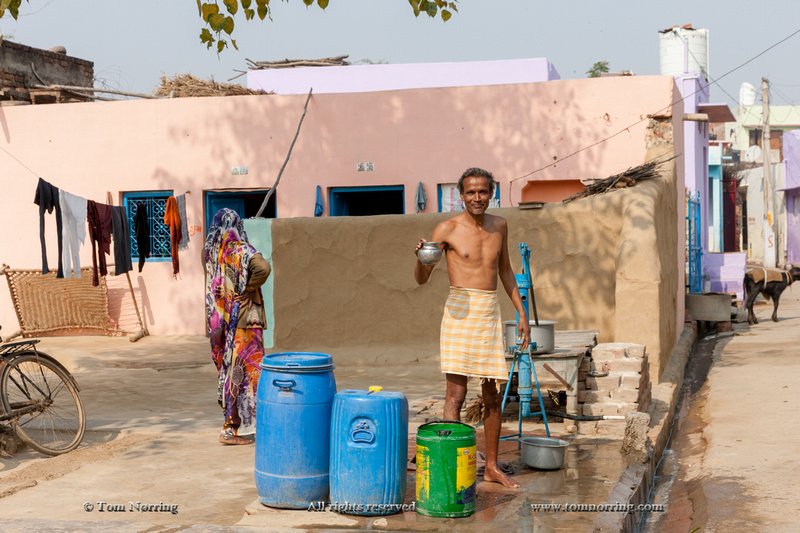 Man pumping water. Fatehpur Sikri village. Bharatpur. Rajasthan. India.