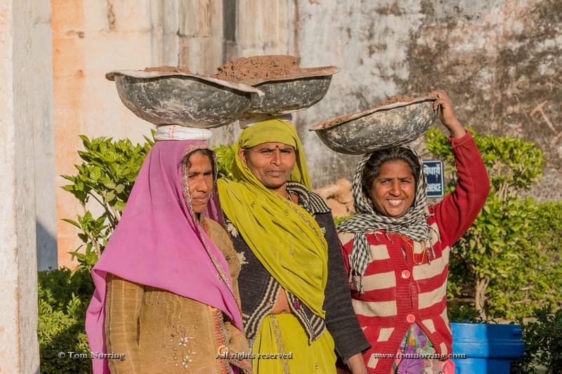 Women carry heavy burden on head. Chittaurgarh Citadel. 6th century. Rajasthan. India.