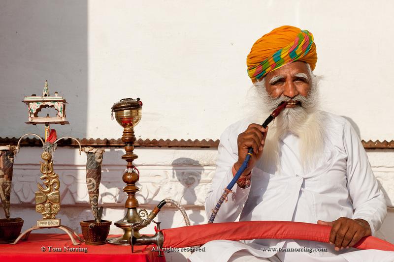 Portrait of man smoking pipe. Mehrangarh Fort. Jodhpur. Rajasthan. India.