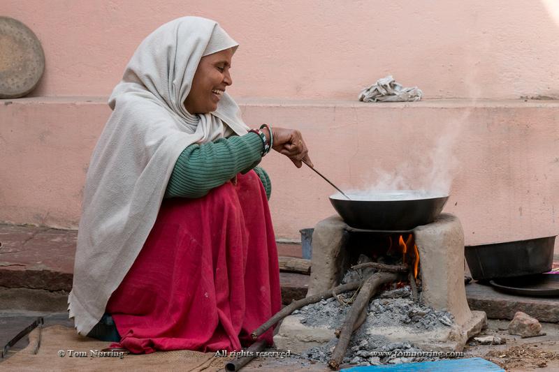 Woman cooking food. Fatehpur Sikri village. Bharatpur. Rajasthan. India.