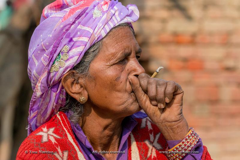 Smoking woman. Fatehpur Sikri village. Bharatpur. Rajasthan. India.