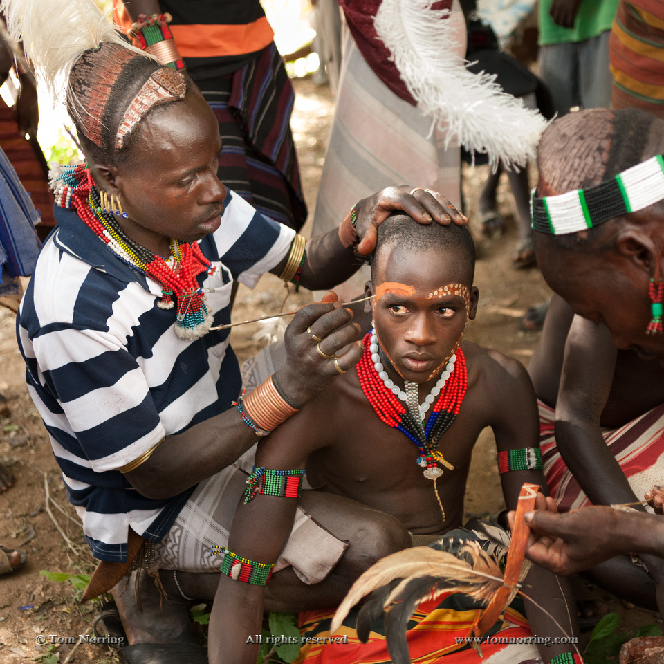 Face painting. Preparing for the Bull Jumping. Hamer tribe. Keske. Omo Valley. Ethiopia,Africa.