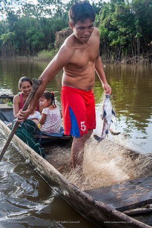 Family Fishing. Amazon basin. Peru. South America.