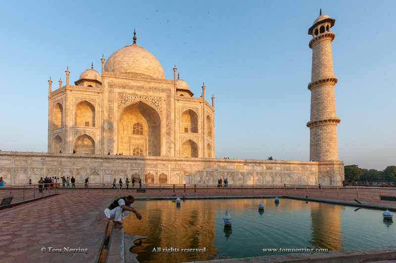 Reflection in water. Taj Mahal at sunset. Agra. India.