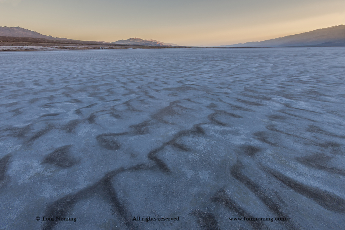 Cracked Salt Flats at sunset. Death Valley. California.