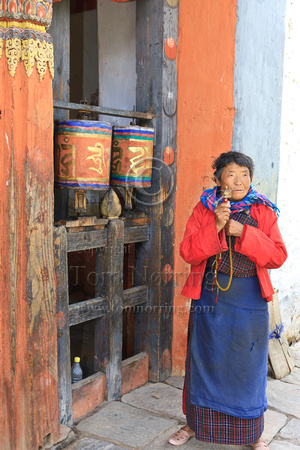 Woman and prayer wheels