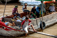 Boat transporting vegetables. Mekong River Delta. Vietnam, Indochina, South East Asia. Orient. Asia.