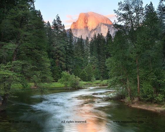 Half Dome with Sunset over Merced River. Yosemite, California, US.